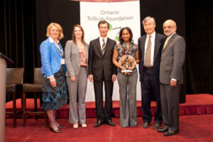 Harmony reps accept Trillium Foundation award.