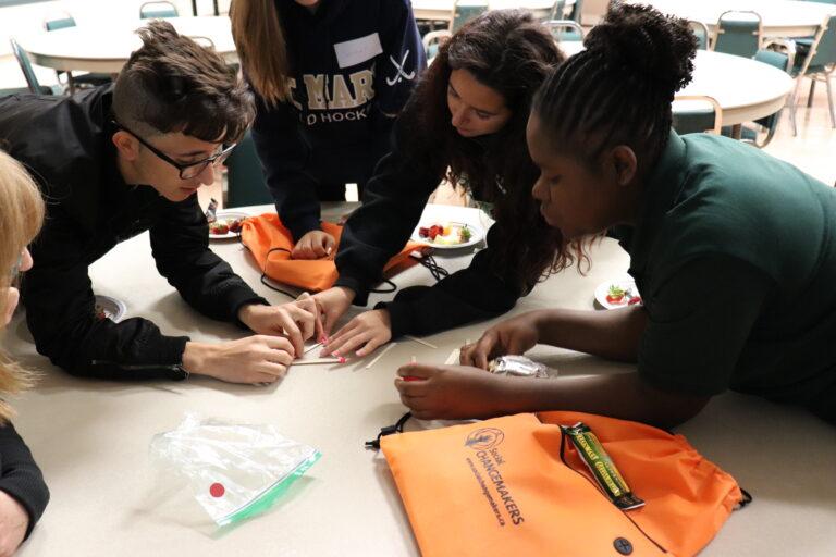 Students gathered around an activity